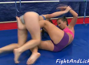 Wrestling babes finger and lick each other